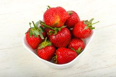 Strawberry in the bowl. Bright Strawberry in the bowl Royalty Free Stock Image