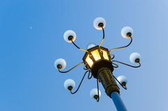 Bright street lights at dusk Royalty Free Stock Photography