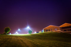 Bright streetlights and a building at night. Royalty Free Stock Photos