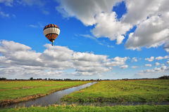 The balloon flies over water channels Royalty Free Stock Photography