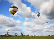 Bright striped balloon flies Stock Images