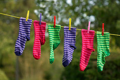 Bright striped socks on clothesline Royalty Free Stock Images