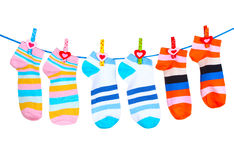Bright striped socks on line. Over the white Stock Photography