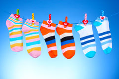 Bright striped socks on line Stock Images