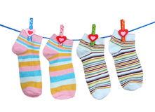 Bright striped socks on line. Over the white Royalty Free Stock Photo