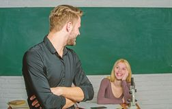Bright student. High school student saying lesson. Male student with examiner at examination. Handsome man standing stock photo