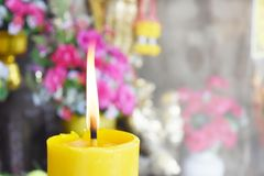 Bright style background. Burning candles and flowers for worship. And empty right space for text stock photography