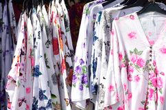 Bright summer dresses  on sale rack Royalty Free Stock Image