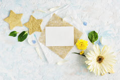 Bright summer flowers mock up with craft paper and gold stars. Greeting card. Text space Stock Images