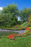 Bright summer garden with pond Royalty Free Stock Photo