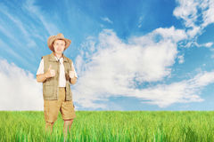 Bright summer landscape with a happy man on field Stock Images