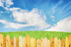 Bright summer landscape with wooden hedge Stock Photo