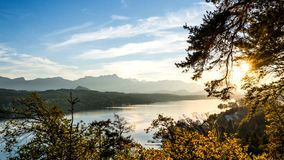 Bright summer morning near the lake near the mountains stock image