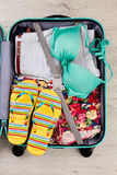 Bright summer stuff in suitcase. Royalty Free Stock Image