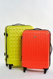 Bright summer suitcases for sale. Plastic wheeled bags for resort, white background Royalty Free Stock Photography