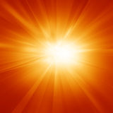 Bright summer sun. On a orange and yellow background Stock Image