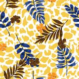 Bright summer Tropical summer floral safari leaves on exotic animal skin leopard prints ,hand drawn style background. Seamless vector pattern on yellow stock illustration