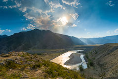 Bright sun above the valley of the river Katun Royalty Free Stock Image