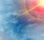 Bright sun beams through clouds Stock Image