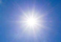 Bright sun on the blue sky stock photography