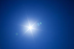 Bright sun in blue sky Royalty Free Stock Image