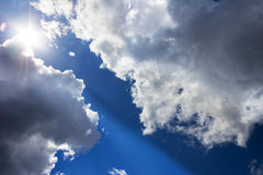 Bright Sun Blue Sky Clouds royalty free stock photography
