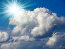 Bright sun in the blue sky. With cumulus clouds. Closeup Royalty Free Stock Images