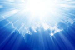 Bright sun, blue sky. Peaceful background - beautiful blue sky with bright sun, light from heaven Stock Photography