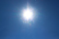 A bright sun in a blue sky Royalty Free Stock Photography