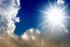 Bright sun and clouds. In blue sky Royalty Free Stock Photo