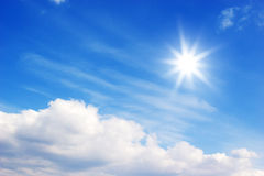 Bright sun and clouds Stock Photo