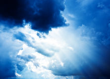 Bright sun in clouds Stock Photos