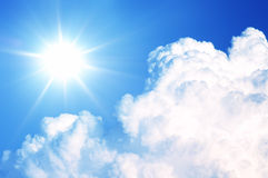 Bright sun and cloud. Blue sky with cloud and the radiant sun stock photography