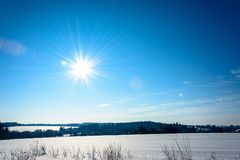 The bright sun descends over the Ukrainian countryside with magnificent rays. The bright sun goes down in winter over the Ukrainian countryside with magnificent Stock Images