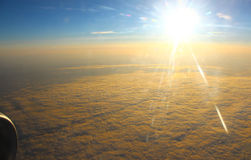 The bright sun illuminates the clouds, view from altitude Stock Photo