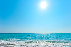 Bright sun over blue sea Stock Photo