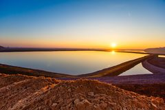 Bright sun over water reservoir royalty free stock photos