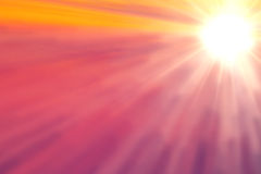 Bright sun on pink and orange sky Stock Photos