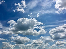 Bright sun, puffy clouds Stock Photos