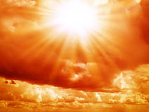 Bright sun in the red sky. With cumulus clouds Royalty Free Stock Image