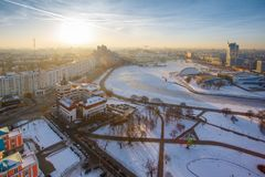Bright sun rising over the downtown on winter early morning royalty free stock photography