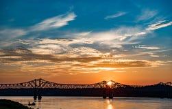 Bright sun rising over river stock photos