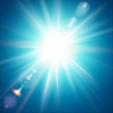 The bright sun shines on a blue sky background. Vector illustration with lens flare effect Stock Photo
