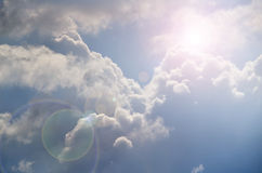 Bright Sun Shines Among The Dark Clouds Stock Images