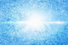 Bright sun shines through frozen window Stock Photos