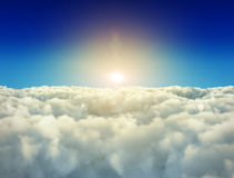 Bright sun is shining over white clouds Royalty Free Stock Photo