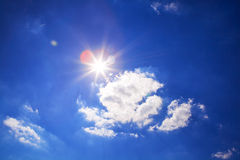 Bright sun in sky. Bright sun and clouds on blue sky royalty free stock photo