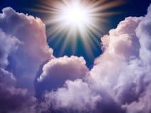 Bright sun in the sky. With cumulus clouds. Closeup Stock Photos