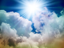 Bright sun in the sky. With cumulus clouds. Closeup Stock Images