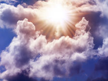 Bright sun in the sky. With cumulus clouds. Closeup Royalty Free Stock Images